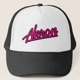Akron in magenta trucker hat
