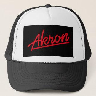 Akron in red trucker hat