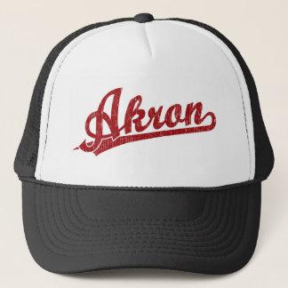 Akron script logo in red trucker hat