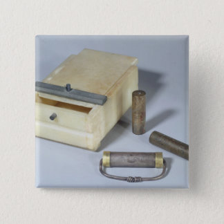 Alabaster box and bronze and silver seal cylinders 15 cm square badge