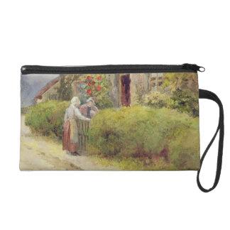 An evening gossip wristlet purses