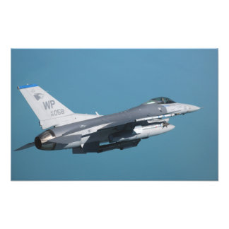 An F-16 Fighting Falcon in flight Photograph