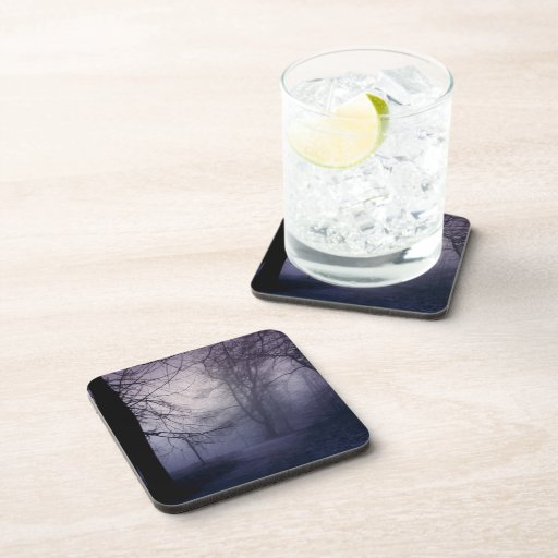 An image of a beautiful forest with fog beverage coaster