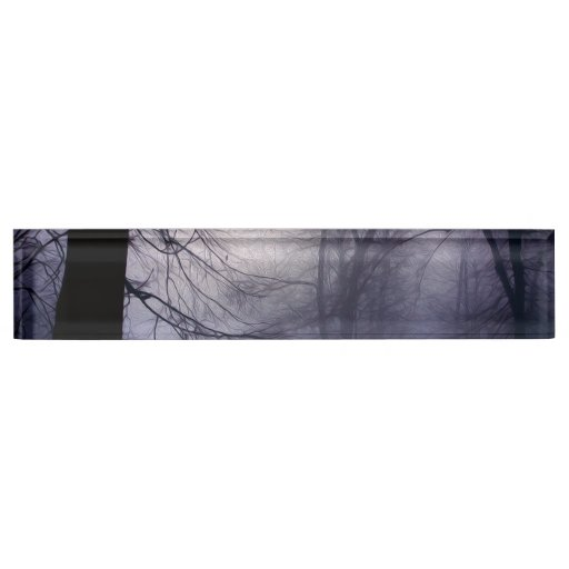 An image of a beautiful forest with fog desk name plates