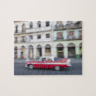 An old car cruising the streets of Havana, Cuba. Jigsaw Puzzle