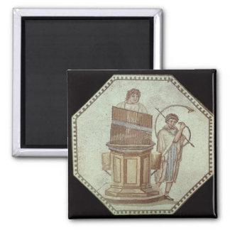 An organist and a horn player entertain fridge magnets
