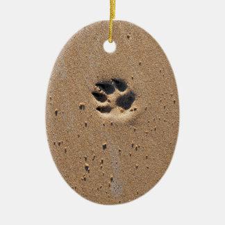 Animal paw print in sand ceramic oval decoration