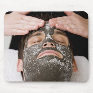 Applying skincare face mask with salt mouse pad