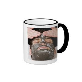 Applying skincare face mask with salt ringer mug