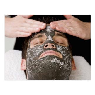 Applying skincare face mask with salt postcard