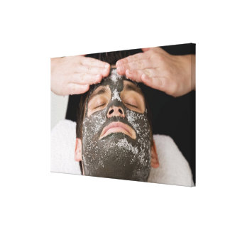 Applying skincare face mask with salt stretched canvas prints