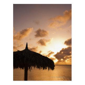 Aruba, silhouette of palapa on beach at sunset postcard
