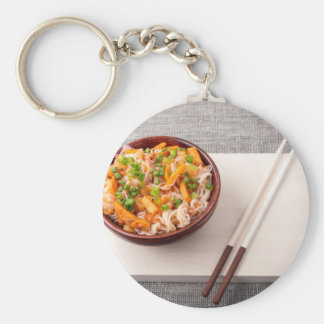 Asian dish of rice noodle and vegetable seasonings basic round button key ring