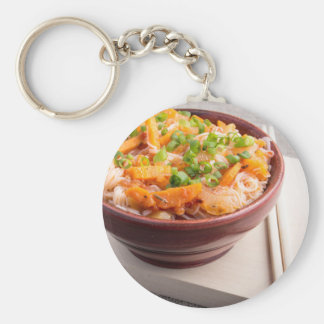 Asian food of rice noodles in a small wooden bowl basic round button key ring