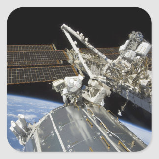 Astronauts perform a series of tasks square sticker