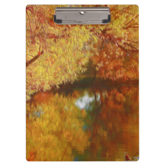 Autumn lake with trees at the river bank clipboard
