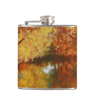 Autumn lake with trees at the river bank hip flask