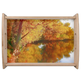 Autumn lake with trees at the river bank serving platters