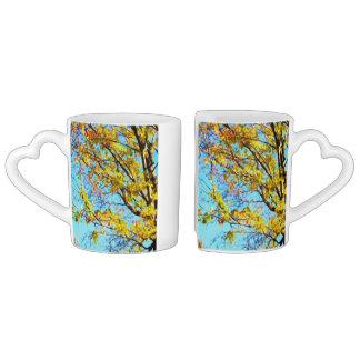 Autumn leaves against blue sky 1 lovers mug