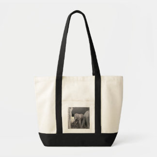 Baby elephant is standing and wobbly tote bag