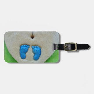 baby feet in blue luggage tag