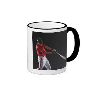 Baseball player about to hit the ball mug