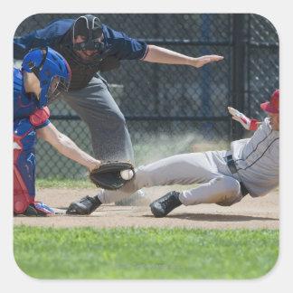 Baseball player sliding into home plate square sticker