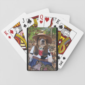 Basset hound puppy playing cards