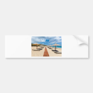 Beach umbrellas and loungers at greek sea bumper sticker