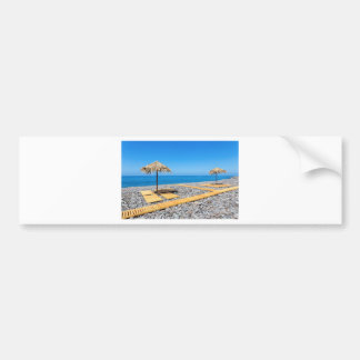 Beach umbrellas with path and stones at coast bumper sticker
