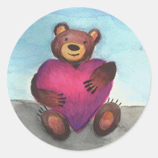 Bear holds heart round sticker