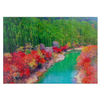 Beautiful autumn forest at the rivers coast cutting boards