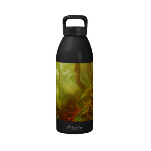Beautiful forest with fog between trees water bottle
