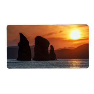 Beautiful seascape: rocky islands at sunset shipping label