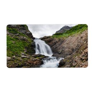 Beautiful waterfall in mountain river shipping label