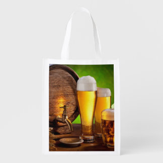 Beer barrel with beer glasses on a wooden table reusable grocery bag
