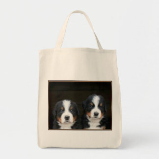 Bernese mountain dog puppies tote bag