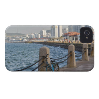 Bicycle at waterfront with Yantai city skyline, iPhone 4 Covers