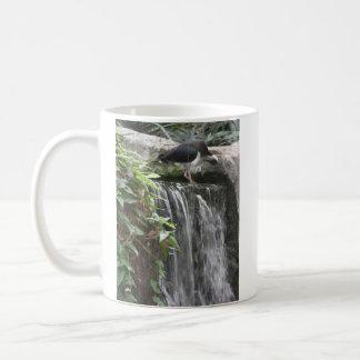 bird standing on waterfall mug