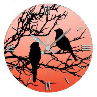 Birds on a Branch, Black Against Sunset Orange Large Clock