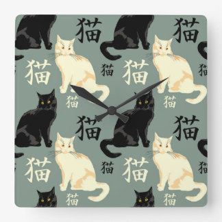 Black and white cats with japanese characters wallclock