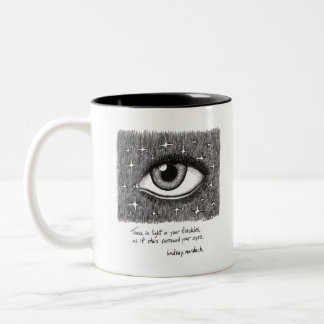 black and white coffee mug with quote and art