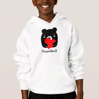 Black bear holding a heart
