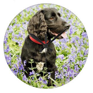 Black dog..Blue flowers Large Clock