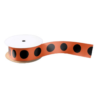 Black polka dots on orange satin ribbon