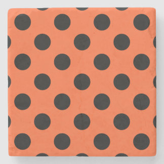 Black polka dots on orange stone beverage coaster