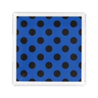 Black polka dots on royal blue