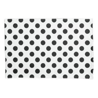 Black polka dots on white pillowcase