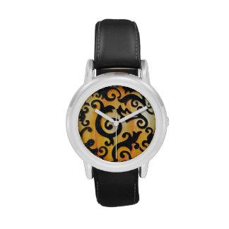 Black scrollwork on orange background watch