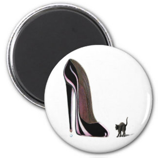 black shoe and scaredy cat magnet